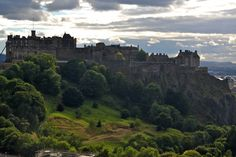 Edinburgh Castle - fortress atop the volcanic Castle Rock - from Princes Street Garden, valley in between New and Old Town.