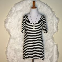 """BCBG MaxAzria Black and White Striped Super comfy black and white striped hi-low blouse. Worn once ot twice but still good condition. Lenght: front's 26"""" and back's 29"""". BCBGMaxAzria Tops Blouses"""