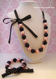 Pink & Black Pearl Lolita Bow Ribbon Necklace AND Bracelet Set. $24.00, via Etsy.
