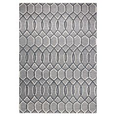 Stylishly anchor your living room or master suite with this elegant hand-tufted wool rug, showcasing an alluring trellis motif in grey.