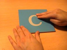 Introduction to Montessori Method of single letter sounds. sandpaper letters - drawing a letter with your finger Montessori Color, Montessori Preschool, Montessori Materials, Sandpaper Letters, Letter Activities, Literacy Activities, Alphabet Tracing, Writing Exercises, Teaching Letters
