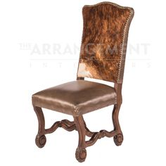 Silla Capital Dining Chair  Elegance in design and upholstery, this hair on hide and leather dining chair has hand carved solid mesquite wood on it's base and features genuine leather for the seat. The beautifully carved turned legs are done by hand, and the combination of leather and cow hair surrounded by nail heads gives this chair a different approach to elegant rustic beauty.
