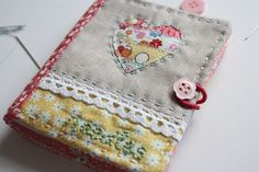 Love Love Love this Needlebook that S at Cheery Heart made.... her blog has a link for the tutorial!