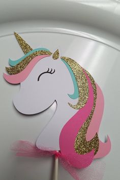 Unicorn cake topper. This cake topper is adorable!! You will receive 1 cake topper 7.5 inches in height not including the stick I have attached a lollipop sticks that can be cut down to fit your cake. I have used some glittery cardstock on the unicorn. These will be a big hit