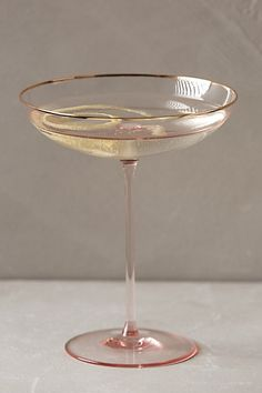 It's the Ballerina of cocktail glasses! The Coupe - so graceful and delicate! Pour me more puhlease! #anthroregistry $28 Gilded Rim Stemware - anthropologie.com