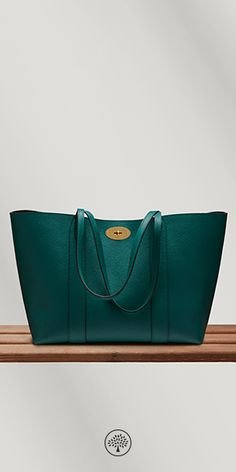 Shop the Bayswater Tote in Ocean Green Small Classic Grain Leather at Mulberry.com. The perfect everyday bag, the Bayswater Tote is eternally practical; spacious enough to fit essentials from an iPad to a pair of shoes. This classic style closes with the iconic postman's lock, and features a luxurious suede lining. Use the internal, removable pocket to store your most valued essentials.