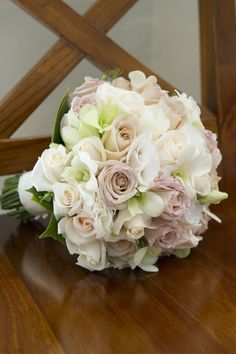 Posy of Antique and Cream Roses, White Lissianthus and White Singapore Orchids