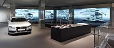 Audi London; 2 birds one stone. Our colleagues at Shopworks worked with Audi London to redesign their shop so that customers could view their entire range interactively. Similarly, it also made a much more exciting office environment for Audi's employees.