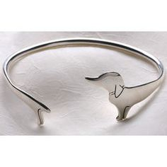 Dachshund Cuff Bracelet  This unique bracelet wraps a dachie completely around your wrist; adjustable for comfort, it's the perfect gift f...
