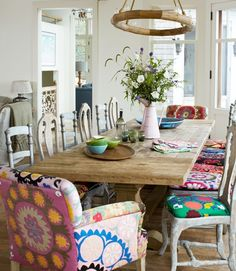 BIG trestle table for family dinners with funky mismatched seat covers....LOVE LOVE LOVE!!!!!