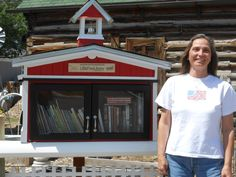 Maria, next to her Little Free Library.