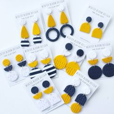 And of course it wouldn't be a @giftsatteacup Restock without some mustard navy and white clay Dangles now would it! Available online this Sunday night.