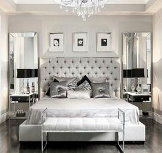 Elegant upscale Monochromatic grey and white luxury bedroom decor with RH tufted bed in get velvet, elegant light grey bedroom.