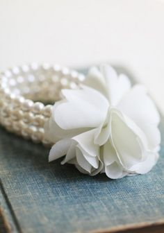 Bridesmaids will all wear a unifying piece of jewelry--this Precious Pearl Flower bracelet from Ruche!