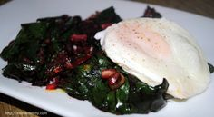 Sauteed beet greens with creamy poached eggs.  A healthy, slender weeknight meal.