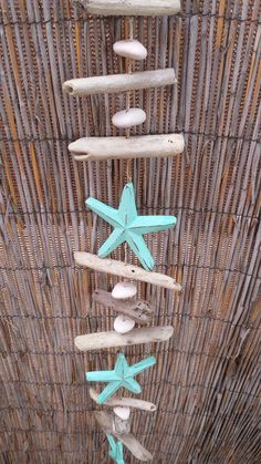 A beautiful accent to any nautical decor inside or outside your home. Measures approximately 36 inches long Each star is made out of wood and