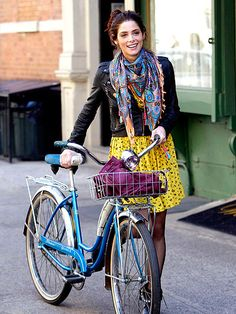I like this look! cropped leather jacket, interesting scarf & a teal/turquoise bike!! Change the hair a little and it's chic! Ashley Greene c/o People Magazine