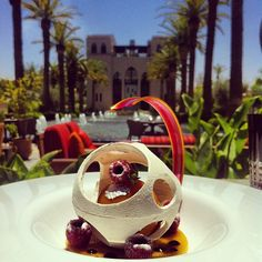 Peach sorbet, jasmine & geranium tea, with fresh raspberries & a white chocolate cage at Dewey Seasons Resort Marrakech