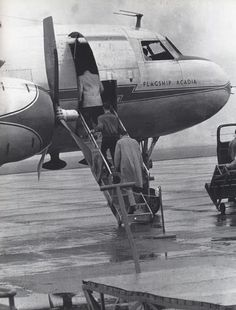 Elvis boarding plane -May 27, 1956 - Dayton, Ohio Photo by Marvin Israel.