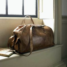 Vintage leather bag, so cool! Dreams of Paradise.