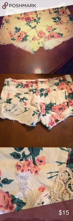 Yellow shorts Floral lace up Yellow/beige shorts with floral print & lace material everything you see is how the shorts came Shorts