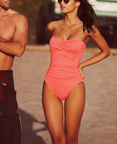 Summer favorite! Love this pink twist front bandeau one-piece swimsuit.