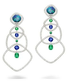 Extremely Piaget earrings in white gold set with two black opals, brilliant-cut diamonds, four cushion-cut sapphires, four cushion-cut emeralds and two round emeralds