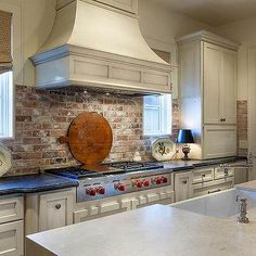 Love the exposed brick back splash, could really do without the casing around the vent hood over the range