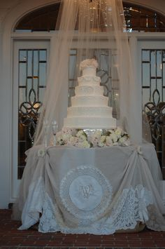 Concept of antique linen and drape to adapt for bride's cake - design by Jenifer Simpson of Mobile.