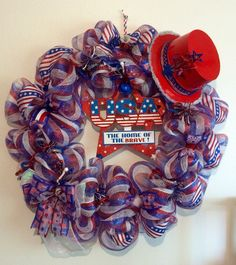 For sale $85 patriotic deco mesh wreath.  to see more visit us on Facebook at laces crafty creations.