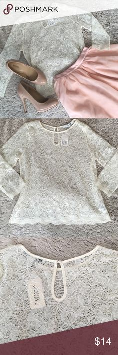 NWT-Ivory Lace Top New w tags. A sheer ivory lace top with 3/4length sleeves.  Satin neckline with a tiny button key hole closure at the back.  Scalloped lace hem on sleeves and waist. Forever 21 Tops