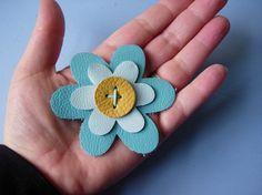 leather flower brooch.
