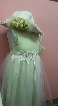 Springtime Bride? How about a spring green flowergirl dress with a matching purse and hat?!