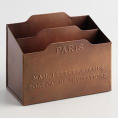 Featuring a distressed copper finish and two handy slots for organizing letters, bills, important papers and more, our embossed mail sorter lends vintage Parisian style to any desktop.