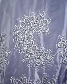 Queen Elizabeth's Norman Hartnell Gown of pale blue and white faille embroidered w white china beads detail of embroidery on skirt