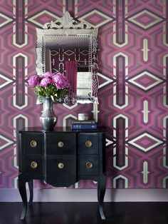Add orchid to your entryway with a bold, wallpapered accent wall like designer Brian Patrick Flynn did here. (http://www.hgtv.com/color/pantones-2014-color-of-the-year-radiant-orchid/pictures/page-2.html?soc=Pinterest)