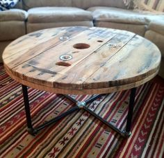 DIY IDEA >>> Round reclaimed / salvaged wood spool table with steel pipe base. Great rustic / industrial style piece - Keith can make?