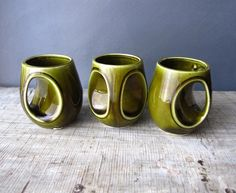 Ceramic Mugs. Probably better for looking at then using but the shape is so unique. And the olive glazes are amazing.