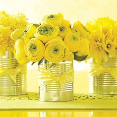 Country-chic vase: Place bunches of farmers-market flowers (like hyacinths, ranunculus, and daffodils) in recycled tin cans and tie with gingham ribbon.