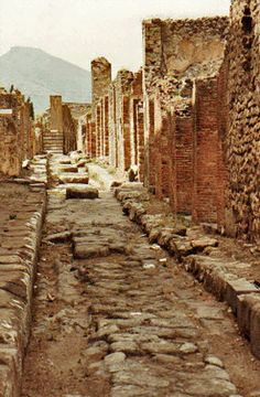 Ancient Road in Pompeii, Campagne, Italy. The John Sinclair novel SUMMER OF FIRE is about volcanoes in Italy.