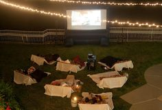 This summer's outdoor movie party theme Backyard Movie Party, Outdoor Movie Party, Outdoor Movie Screen, Backyard Movie Nights, Outdoor Movie Nights, Movie Night Party, Doors Movie, Garage Party, Red Carpet Party