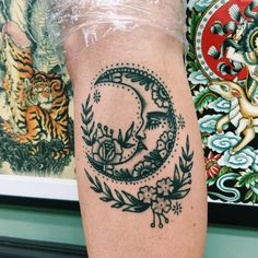 intricate floral moon tattoo
