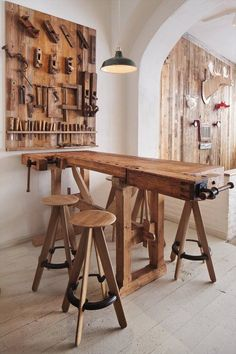 Use an old work bench as a table and decorate the wall with old tools. interesting.