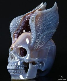 - Spirit of Flight - Agate Amethyst Geode Carved Crystal Skull with Wings Sculpture