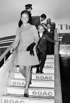 Princess Muna, the wife of King Hussein of Jordan, arrives at Heathrow Airport, London with their sons Prince Abdullah and Prince Faisal for a family holiday on 10 Sep 1969