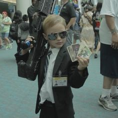 This kid cosplayed as Phil  Colson at 2013 comic con...I can only hope my kid is this awesome