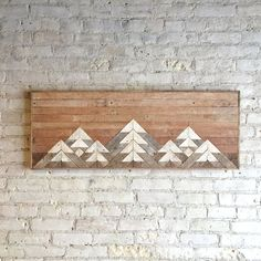 This one of a kind wall art is made from reclaimed wood. The finish is left completely natural to give it rustic character and interest. This piece will add warmth and character to any room and is sure to be a conversation piece. The mountain range under an ombre sky is the perfect gift for anyone with adventure in their heart.  The color is achieved over time and can not be manufactured to the same aesthetic. Each piece of wood is full of texture and age that brings a depth that only 100…