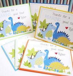 """Personalized Dinosaur Thank You Cards for Birthday or Baby Shower.   A set of 4 Dinosaur Thank You Note Cards that are so cute, personalized with a name. These Dino cards are perfect for Dinosaur Baby Shower or Birthday party. These are folded cards. On the front of the card, it says: """"Thanks for a Roaring good time!"""", adorned with three cute dinosaurs. The inside is left blank to hand write your personal message."""