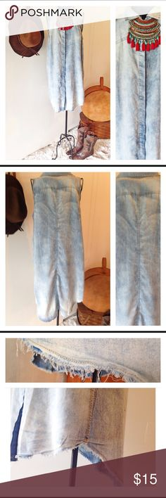Denim sleeveless dress This is a denim look sleeveless dress. The material is actually cotton and polyester. It is made to look washed out and distressed.The bottom has a frayed look and the material has a washed out look to it. It is a size large. It is 32 inches long in  the front and 38 inches long in the back. It has been worn but in great condition. Dresses