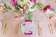 This picnic-like tablescape is perfect for spring, with its gold and purple accents and checkerboard tablecloth. Check out more from this styled shoot here.